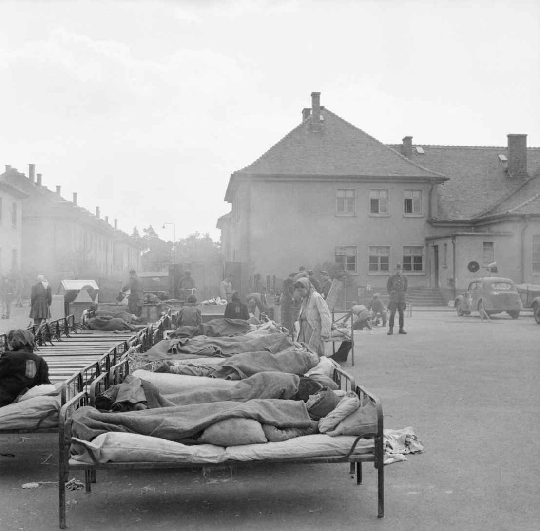 Former Wehrmacht barracks in Belsen: Open-air emergency hospital, 27 April 1945. Photo by Sgt. Oakes. Imperial War Museum, London, Photograph Archive, BU 4844.