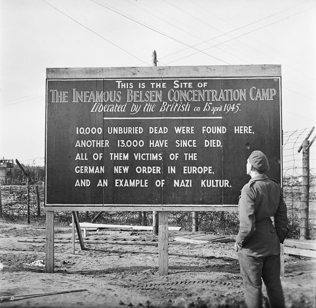 Sign at the former entrance to the camp, 29 May 1945. Photo by Sgt. Hewitt. Imperial War Museum, London, Photograph Archive, BU 6955.